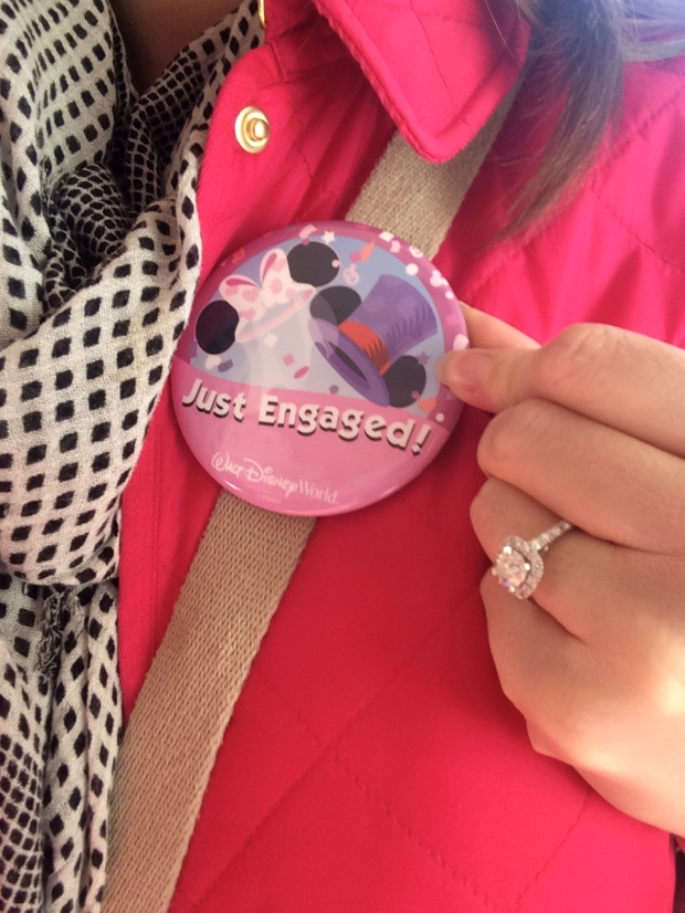 "Sporting my ""just engaged"" button"